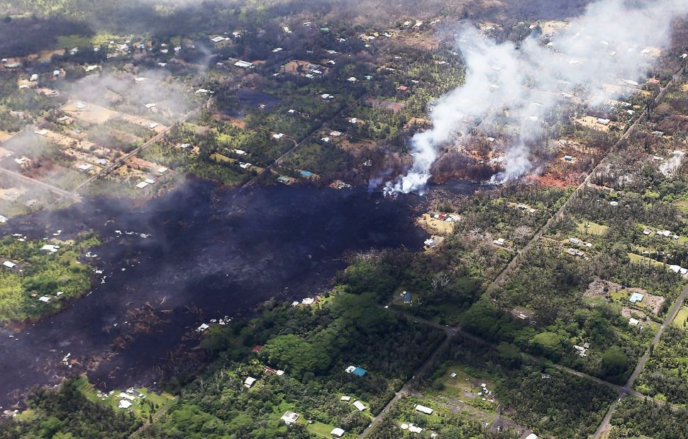 Smoke and volcanic gases rise as lava cools in the Leilani Estates neighborhood, in the aftermath of eruptions and lava flows
