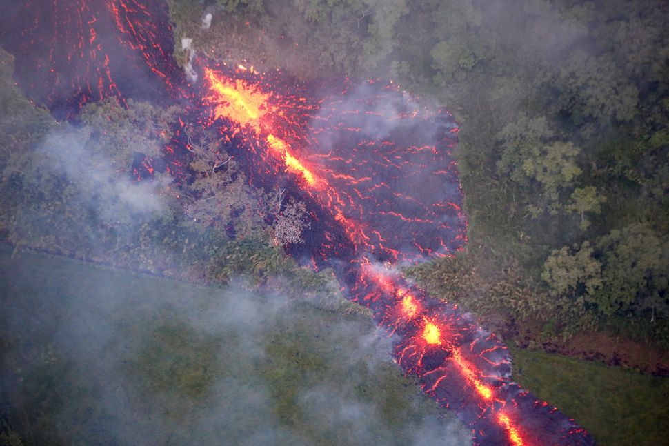 Lava erupts from a fissure east of the Leilani Estates subdivision during ongoing eruptions on May 13, 2018.