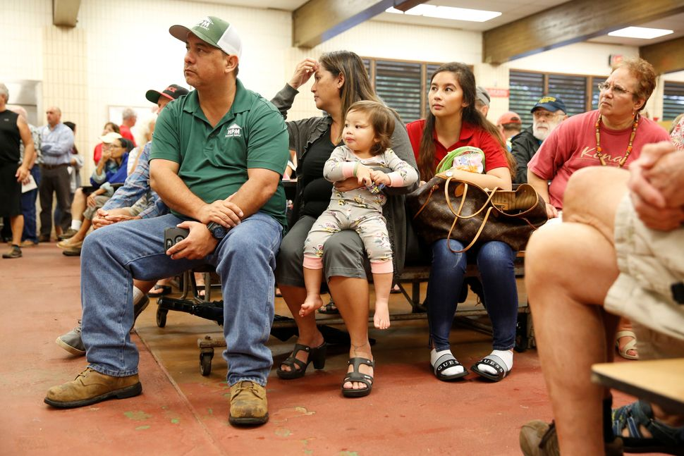 Puna District resident Ray Kaaihue (L), 47, listens with his wife Jennifer, 46, their daughter Kieryn, 22, and Kieryn's daugh