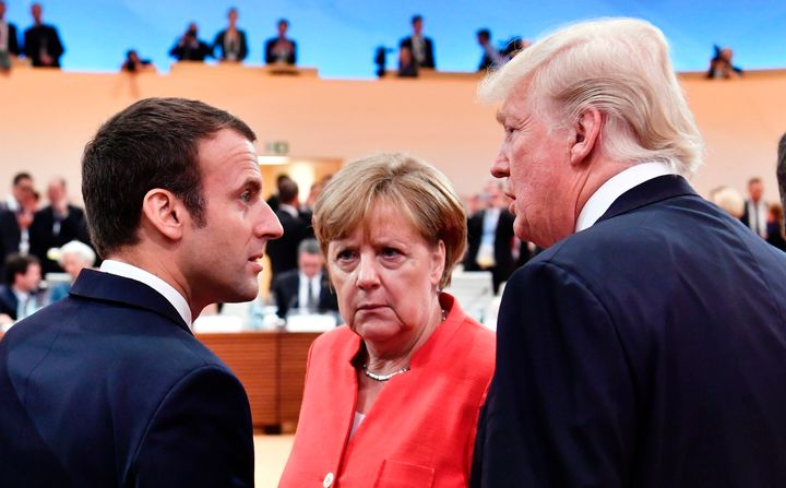 French President Emmanuel Macron, German Chancellor Angela Merkel and U.S. President Donald Trump confer at the start of the first working session of the G-20 meeting in Hamburg, Germany, on July 7, 2017.