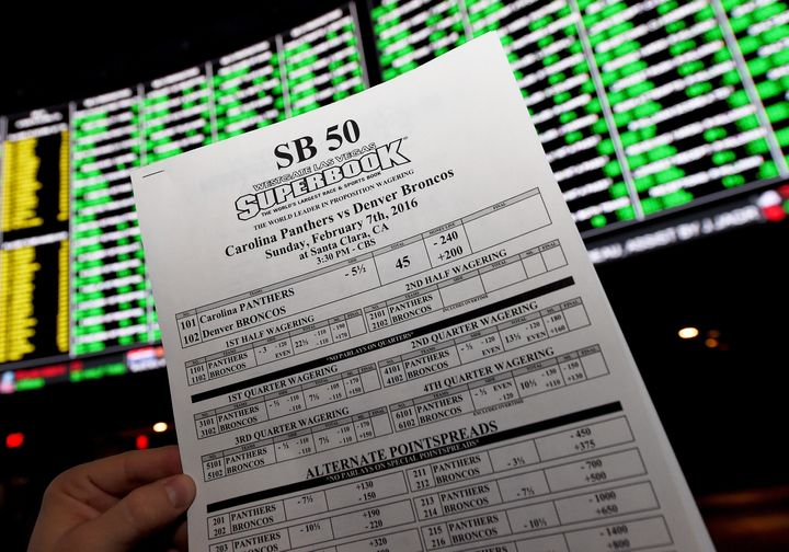 A betting sheet for Super Bowl 50 between the Carolina Panthers and the Denver Broncos is displayed at the Race & Sports
