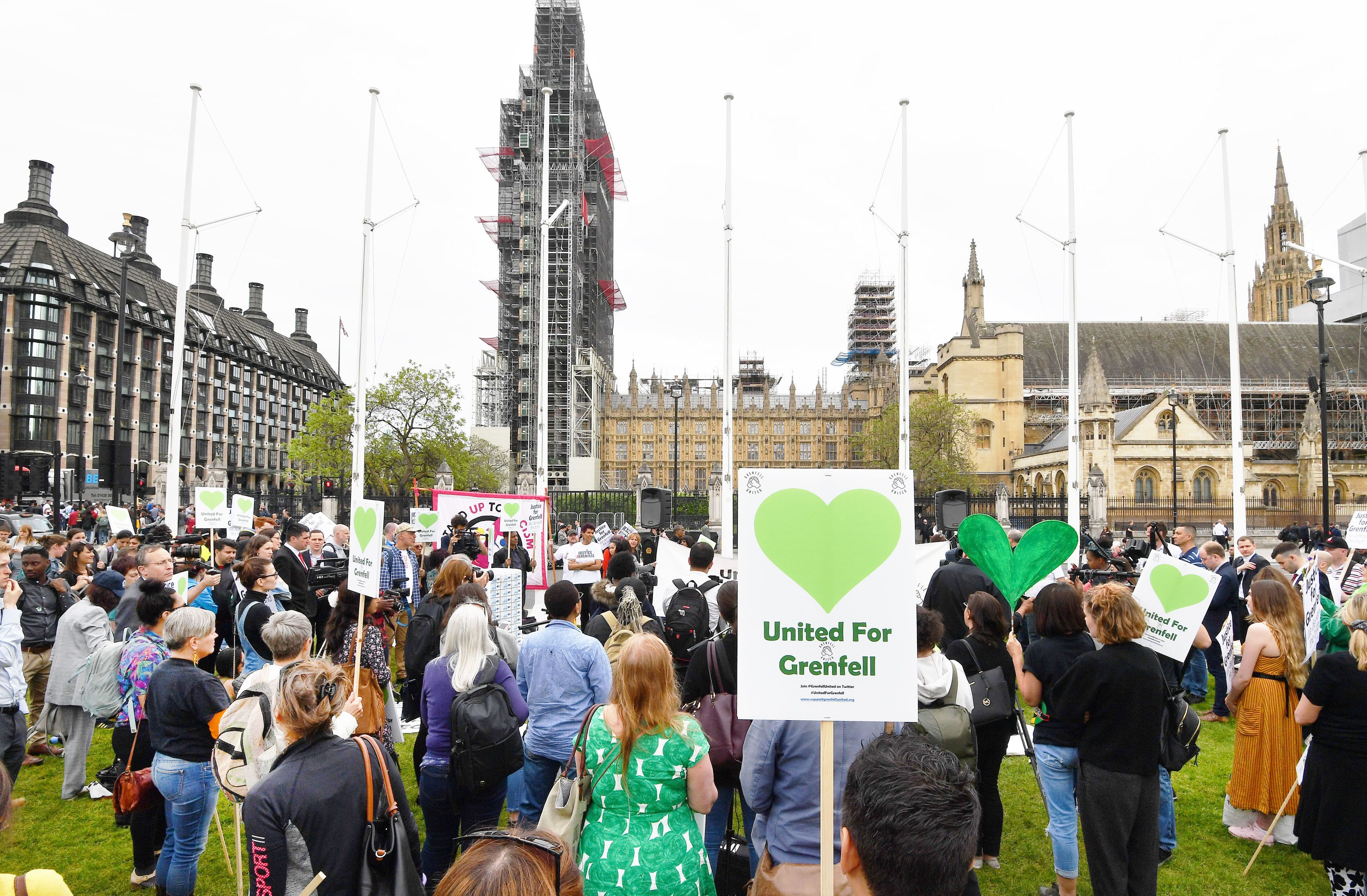 Grenfell Families Tired Of 'Begging' Theresa May For Answers Hold Mass Protest Outside Parliament