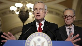 Senate Minority Leader Harry Reid (D-NV) speaks during a news conference as Senator Charles Schumer (D-NY) listens on Capitol Hill in Washington March 8, 2016. REUTERS/Joshua Roberts