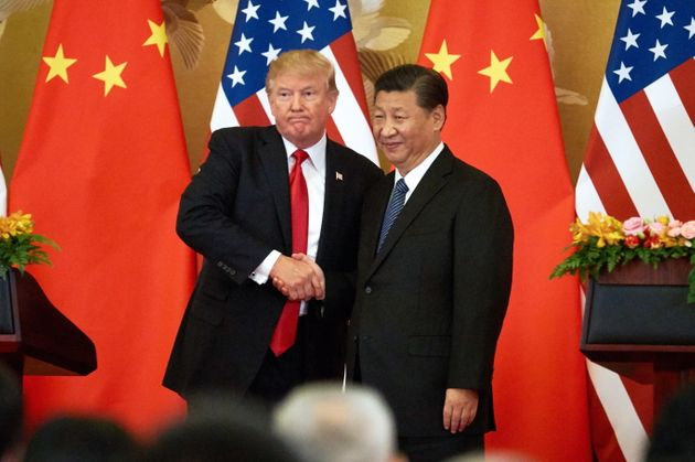President Donald Trump and China's President Xi Jinping shake hands in Beijing on Nov. 9,