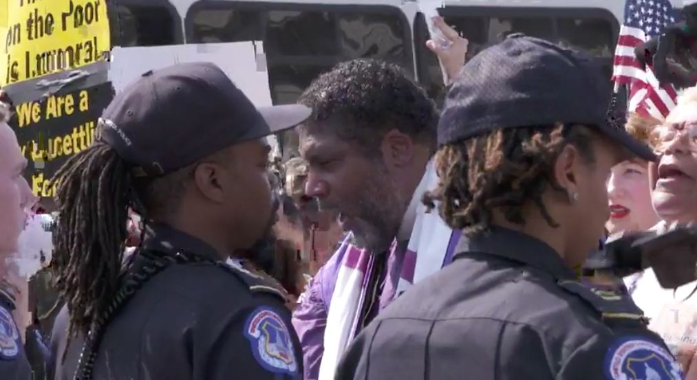 Rev. Barber chants in front of the police line at a Washington, D.C., rally.