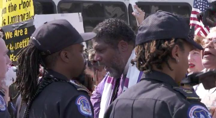 Rev. Barber chants in front ofthe police line at a Washington, D.C., rally.
