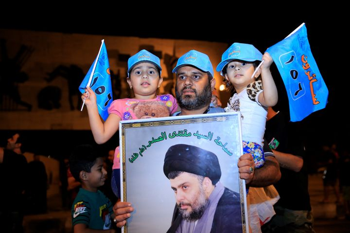 Supporters of Iraqi Shi'ite cleric Muqtada al-Sadr celebrate the results of the parliamentary election in Baghdad on Sun