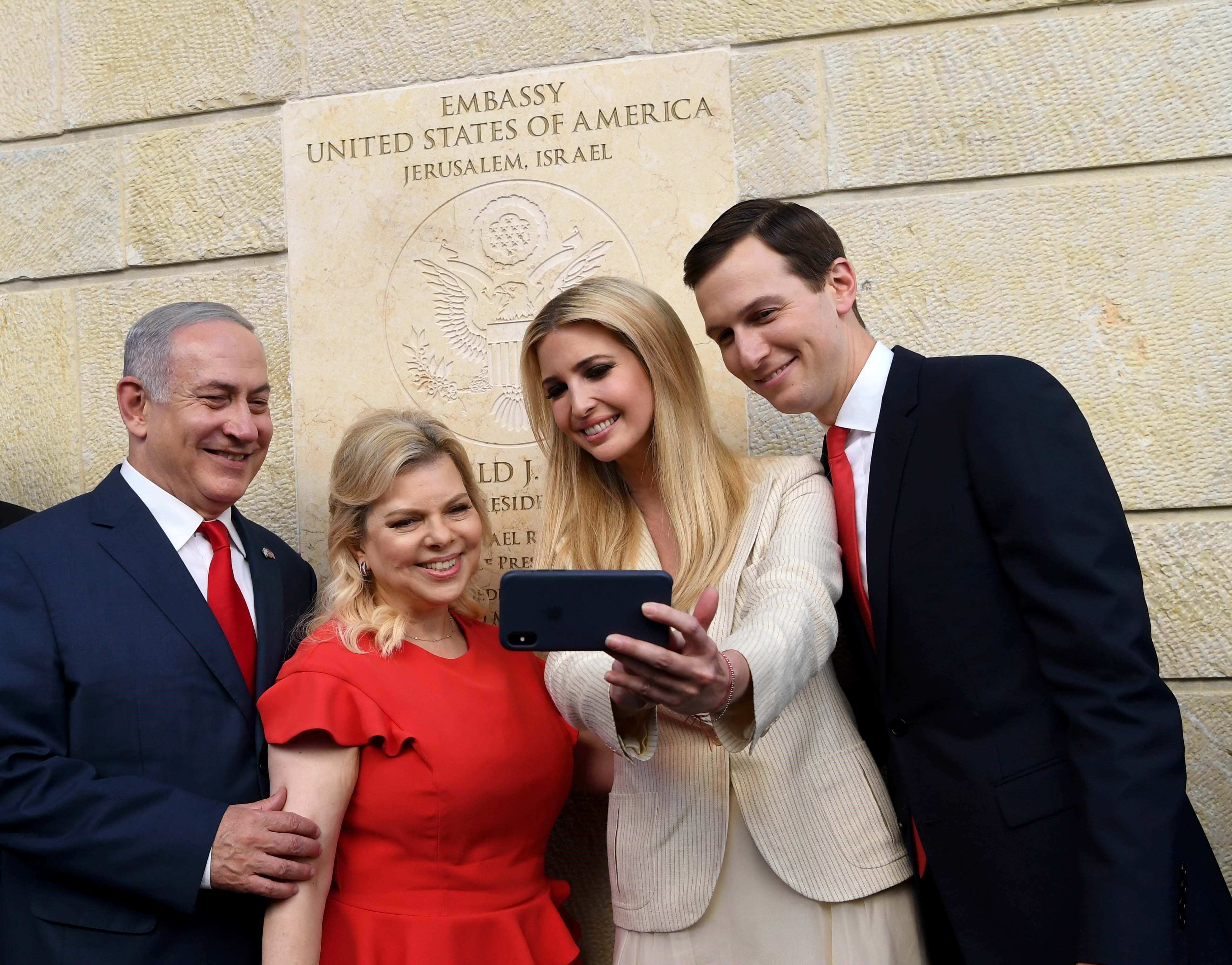 JERUSALEM - MAY 14: (----EDITORIAL USE ONLY  MANDATORY CREDIT - 'ISRAEL PRESS OFFICE / HANDOUT' - NO MARKETING NO ADVERTISING CAMPAIGNS - DISTRIBUTED AS A SERVICE TO CLIENTS----) US President's daughter Ivanka Trump (left 3) Israel Prime Minister's wife Sara Netanyahu (left 2), Donald Trump's son-in-law and Senior Advisor Jared Kushner (R) and Israel's Prime Minister Benjamin Netanyahu (L) attend the opening of the US embassy in Jerusalem on May 14, 2018.  (Photo by Israel Press Office /Handout/Anadolu Agency/Getty Images)