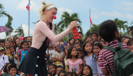From Refugee Camps To War Zones, It's A Privilege To Bring Laughter To Children Struggling Around The