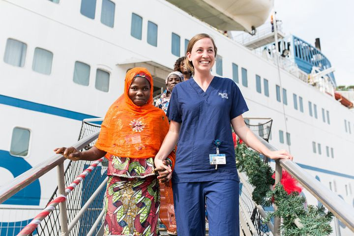 Mariamou after her surgery with volunteer nurse Lucy Hedges, leaving the ship.