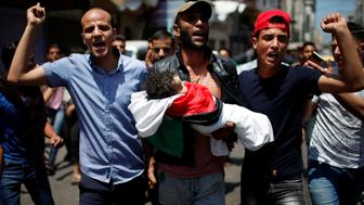 ATTENTION EDITORS - VISUAL COVERAGE OF SCENES OF INJURY OR DEATH Mourners carry the body of eight-month-old Palestinian infant Laila al-Ghandour, who died after inhaling tear gas during a protest against U.S embassy move to Jerusalem at the Israel-Gaza border, during her funeral in Gaza City May 15, 2018. REUTERS/Mohammed Salem  TEMPLATE OUT