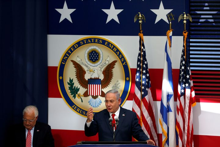 Israeli Prime Minister Benjamin Netanyahu speaks as U.S. Ambassador to Israel David Friedman sits next to him during the dedi