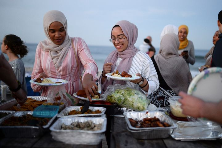 Muslim American friends take part in the last Iftar of Ramadan, ahead of Eid al-Fitr celebrations, on a beach in Long Branch,