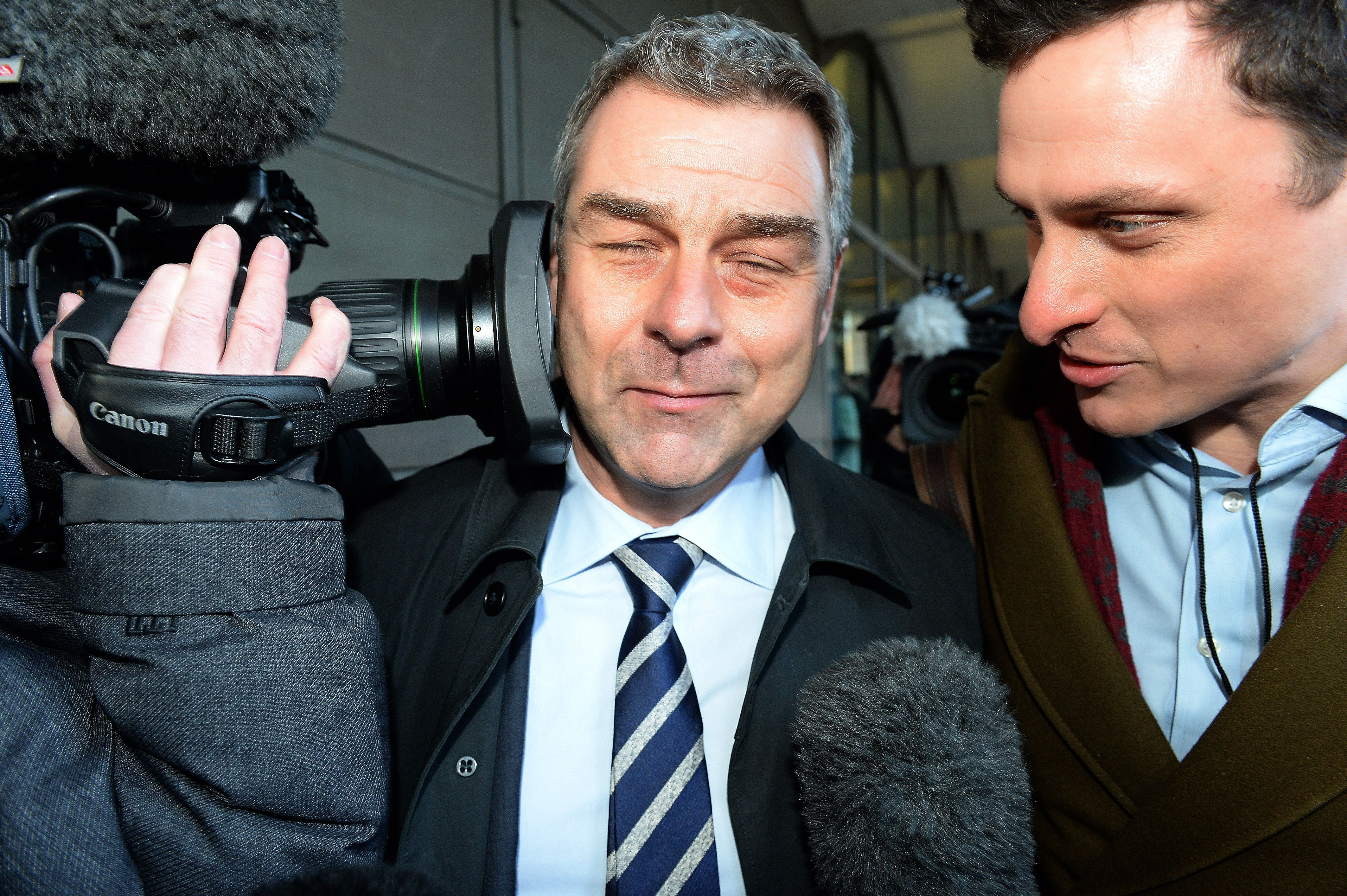 Richard Howson, former Chief Executive, reacts as a TV camera is pressed into his face leaves, as he leaves Portcullis House in London after answering MPs' questions.