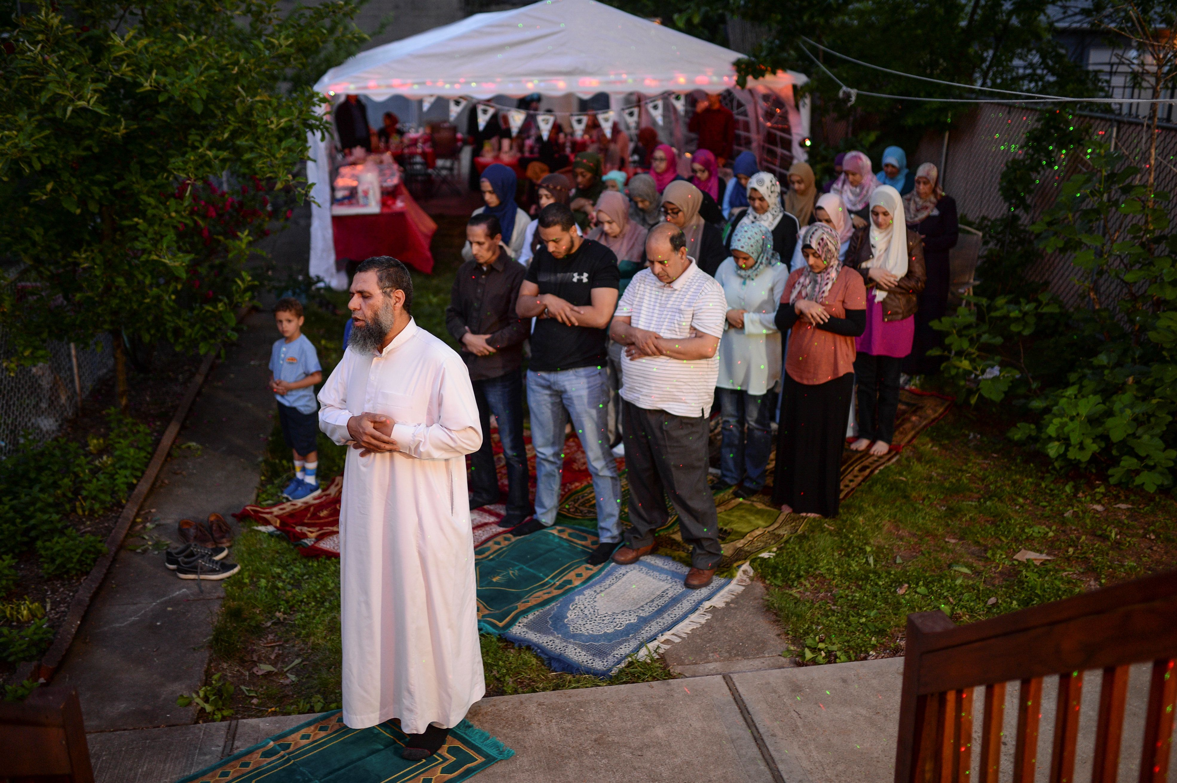 An imam leads a Maghrib sunset prayer during Ramadan for a family in Bayonne, New Jersey, on June 2, 2017.