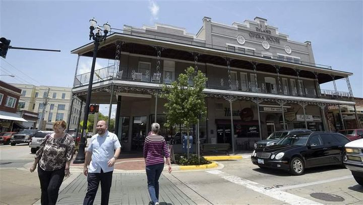 Pedestrians walk past the Deland Opera House in downtown Deland, Fla. Between 2009 and 2016, pedestrian deaths in Florida ros