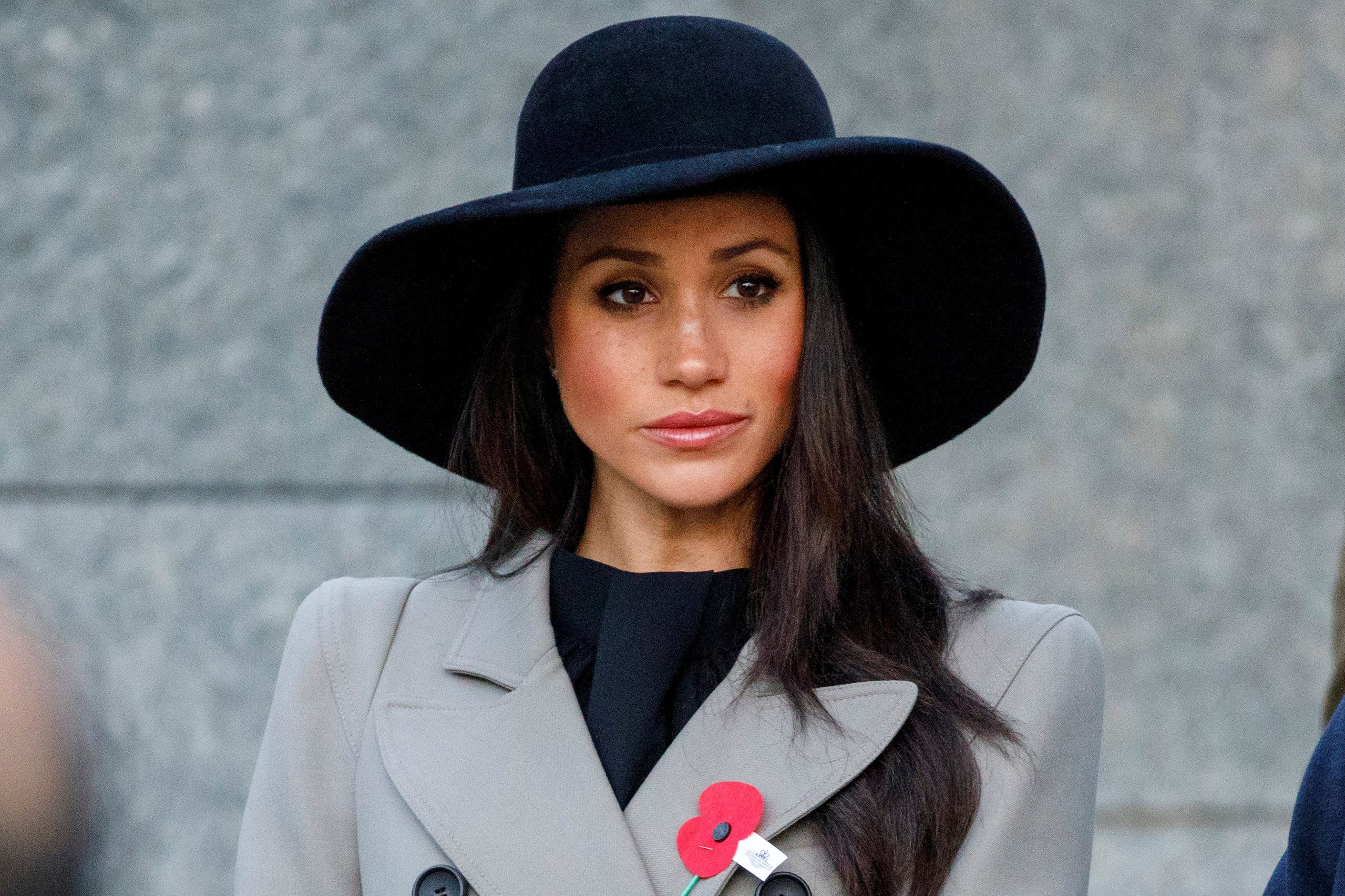 Meghan Markle, the fiancee of Britain's Prince Harry, attends the Dawn Service at Wellington Arch to commemorate Anzac Day in London, Britain, April 25, 2018. Tolga Akmen/Pool via Reuters