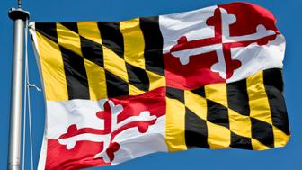 The colorful flag of the state of Maryland flying in a stiff breeze.