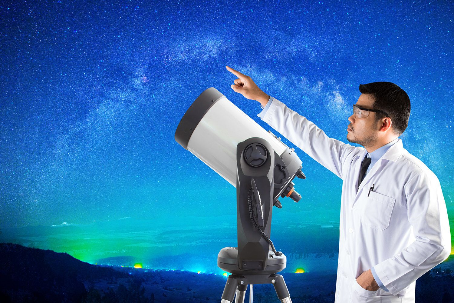 Astronomer pointing at milky way and space telescope of observatory. elements of this image furnished by NASA.