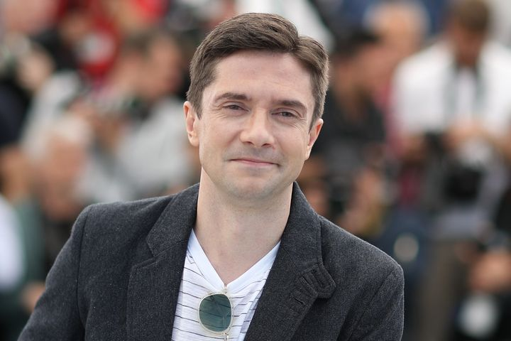 """Topher Grace poses on Tuesday during a photocall for the film """"BlacKkKlansman"""" at the Cannes Film Festival in France."""