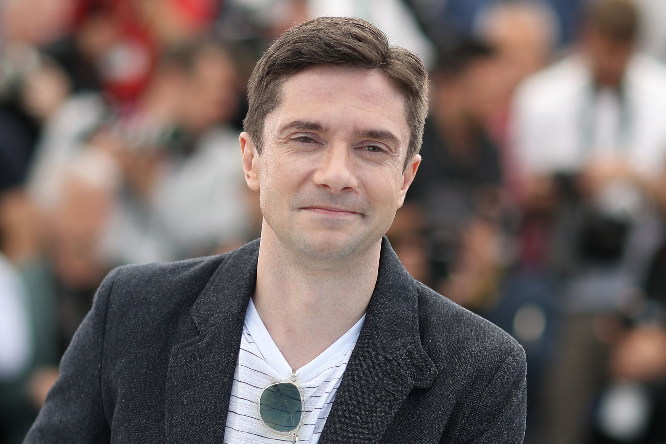 "Topher Grace poses on Tuesday during a photocall for the film ""BlacKkKlansman"" at the Cannes Film Festival in France."