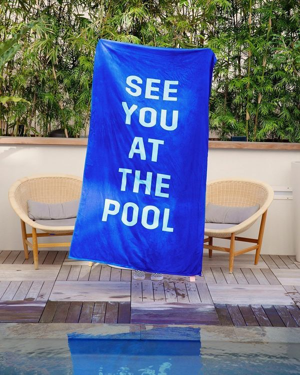 "Get it on <a href=""https://www.bando.com/collections/beach-towels/products/beach-please-giant-towel-see-you-at-the-pool"" targ"