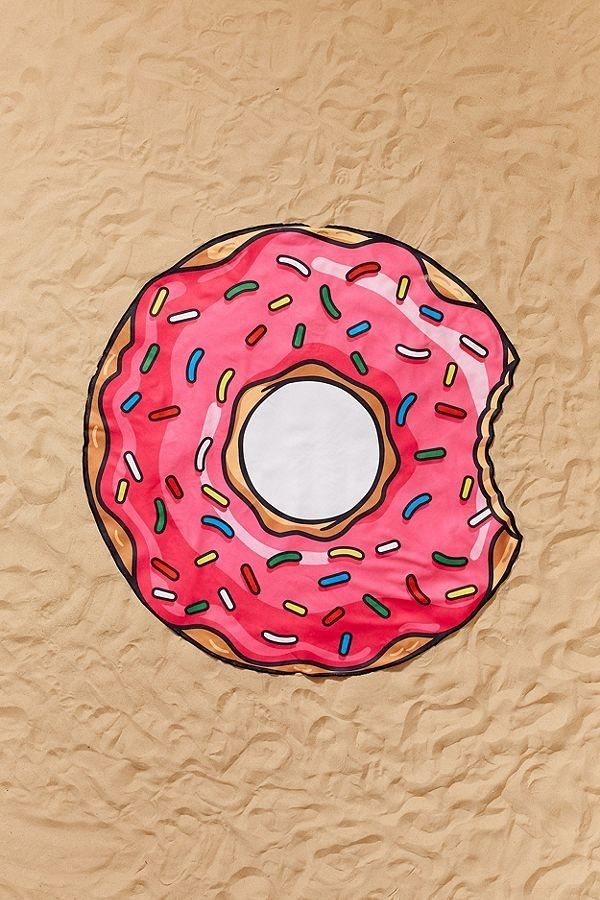 "Get it on <a href=""https://www.urbanoutfitters.com/shop/bigmouth-donut-beach-blanket"" target=""_blank"">Urban Outfitters</a>, $"