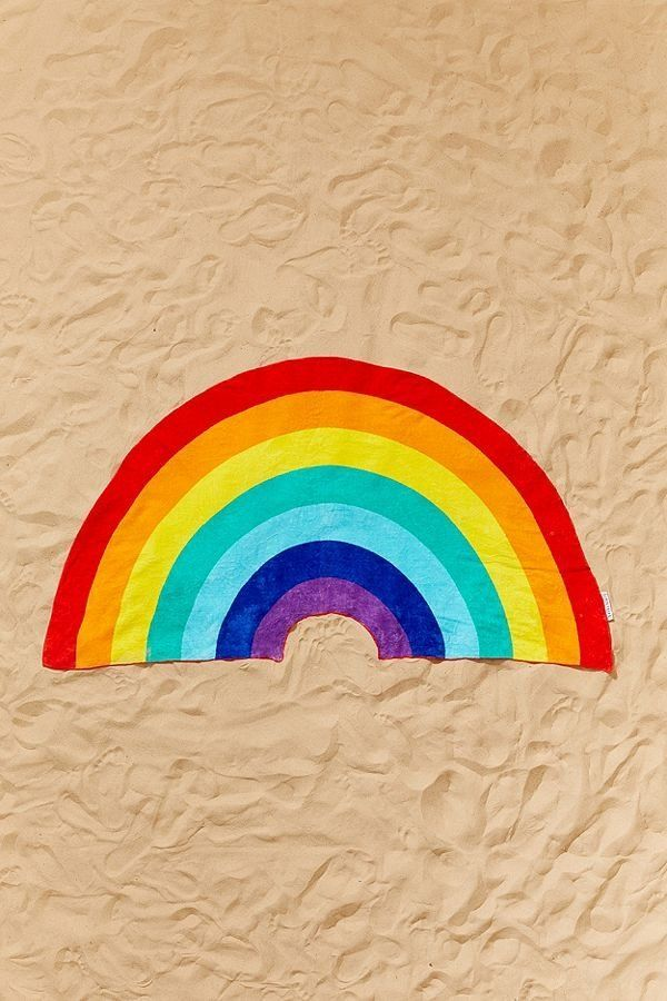 "Get it on <a href=""https://www.urbanoutfitters.com/shop/sunnylife-rainbow-shaped-beach-towel"" target=""_blank"">Urban Outfitter"