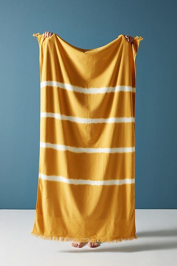 "Get it on <a href=""https://www.anthropologie.com/shop/stripe-dyed-beach-towel?category=swimwear-beach-towels&color=045"" t"
