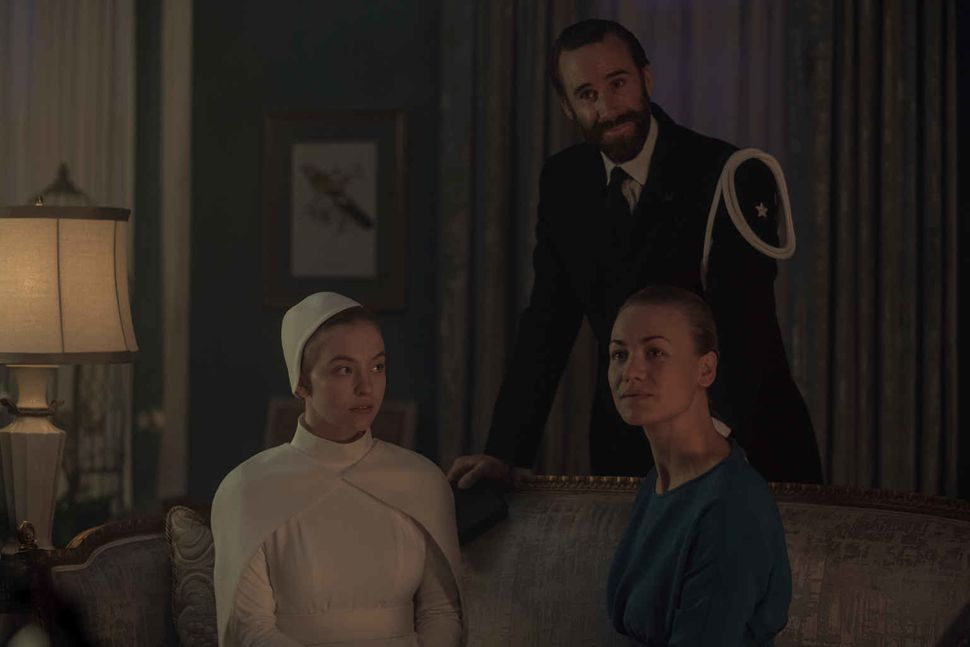 "Sydney Sweeney, Joseph Fiennes and Yvonne Strahovski in ""The Handmaid's Tale."""