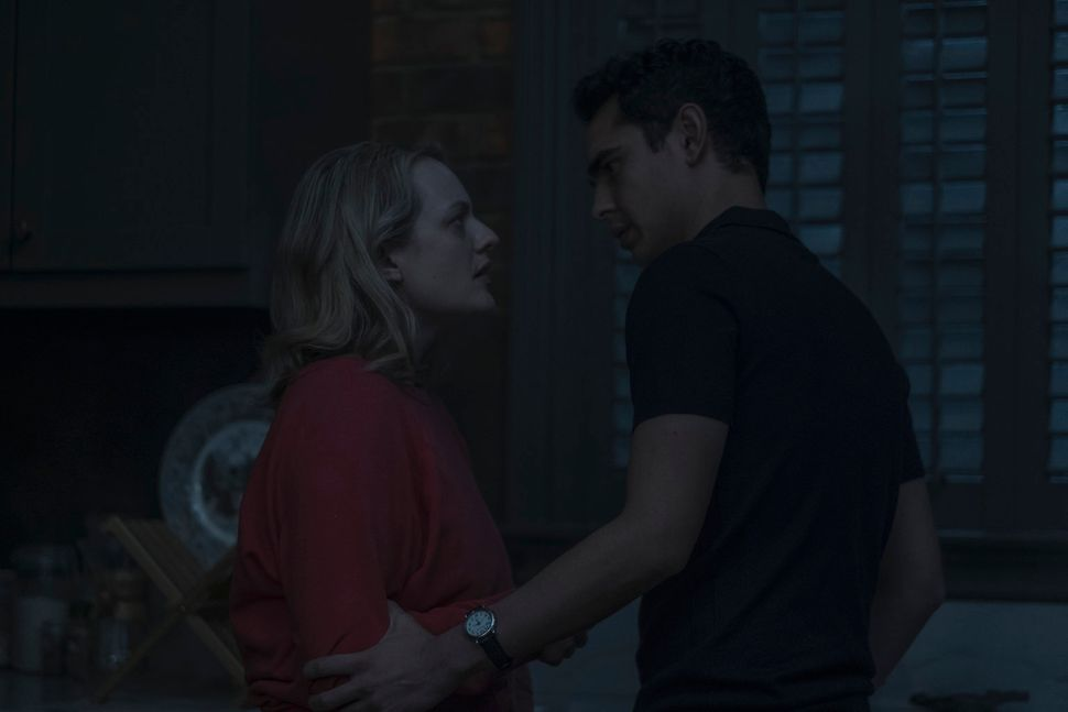 "Elisabeth Moss and Max Minghella in ""The Handmaid's Tale."""