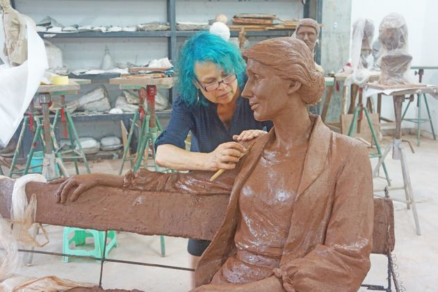The sculptor, Laury Dizengremel, at work on the