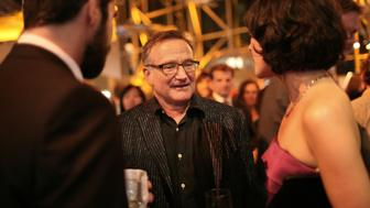 WASHINGTON - MAY 14: Jeffrey Shagawat, Robin Williams and Mizuo Peck attend the party following the premiere of 'Night At The Museum: Battle Of The Smithsonian' at the National Air and Space Museum on May 14, 2009 in Washington, DC. (Photo by Abby Brack/WireImage)