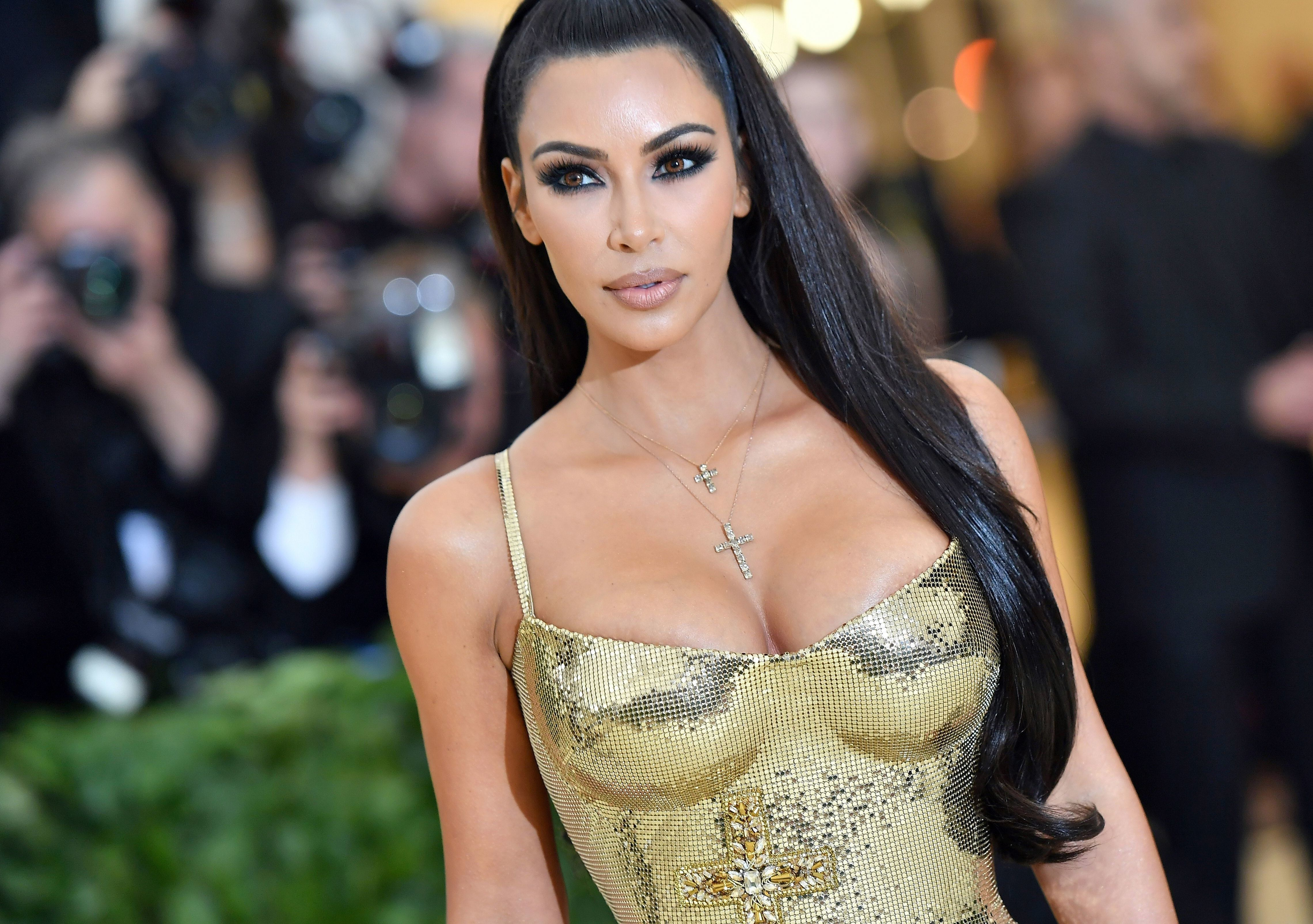Kim Kardashian arrives for the 2018 Met Gala on May 7, 2018, at the Metropolitan Museum of Art in New York. - The Gala raises money for the Metropolitan Museum of Arts Costume Institute. The Gala's 2018 theme is Heavenly Bodies: Fashion and the Catholic Imagination. (Photo by ANGELA WEISS / AFP)        (Photo credit should read ANGELA WEISS/AFP/Getty Images)