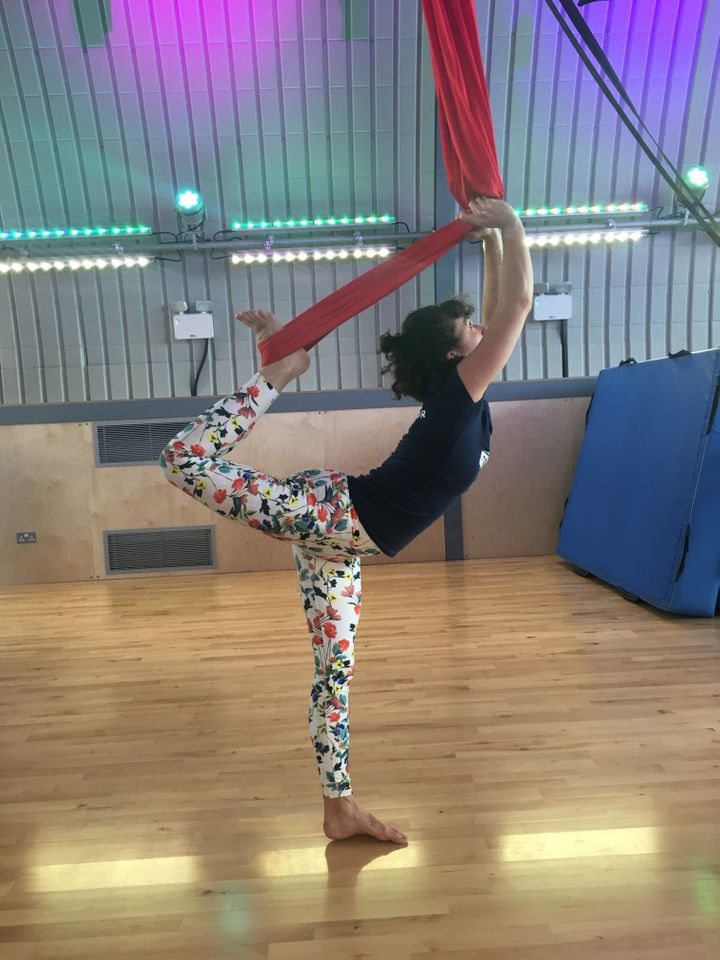 Using the sling to get deeper into dancer's pose.