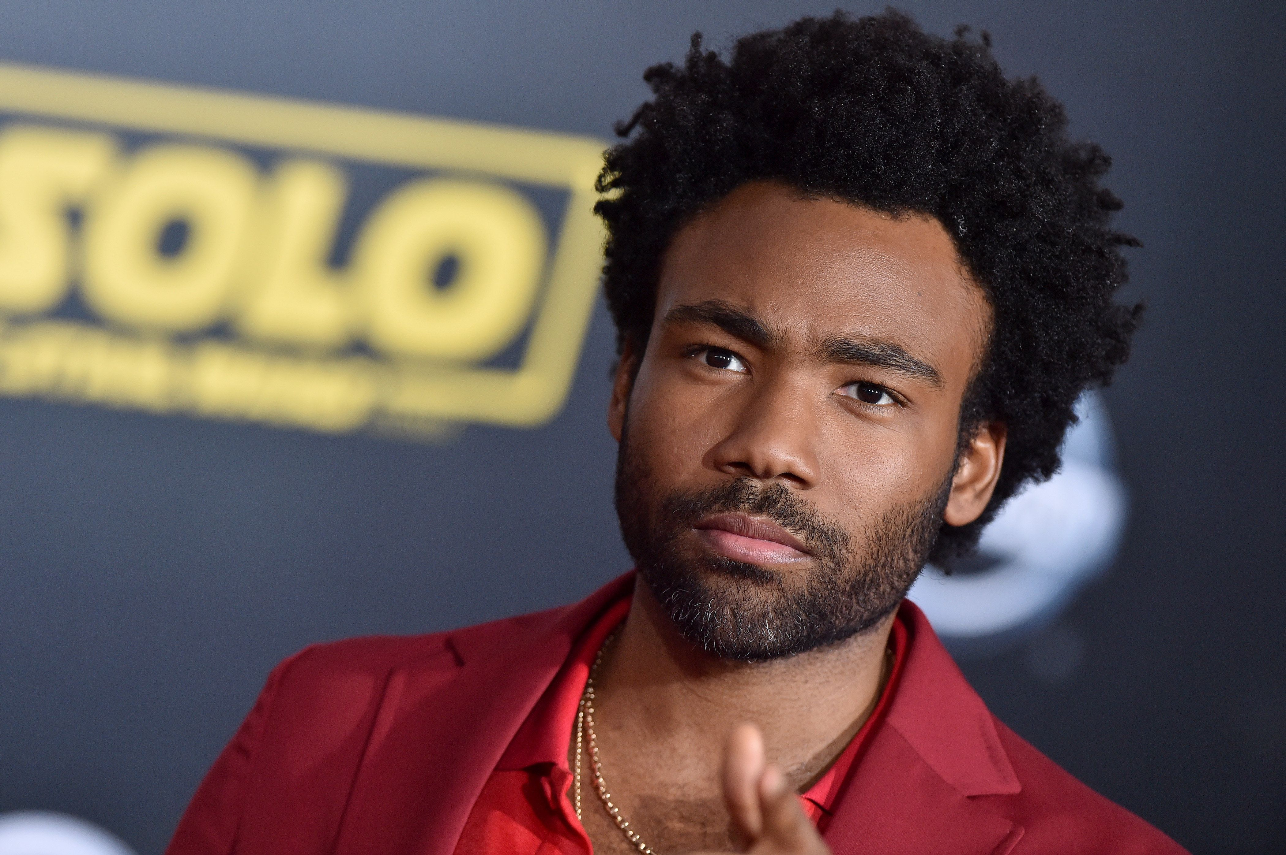HOLLYWOOD, CA - MAY 10:  Actor Donald Glover arrives at the premiere of Disney Pictures and Lucasfilm's 'Solo: A Star Wars Story' at the El Capitan Theatre on May 10, 2018 in Hollywood, California.  (Photo by Axelle/Bauer-Griffin/FilmMagic)