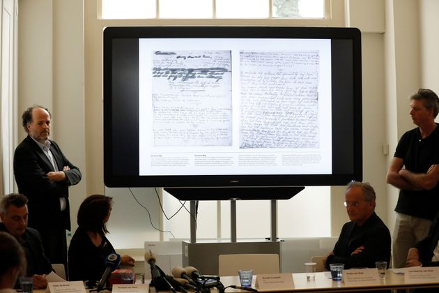 Ronald Leopold (left), executive director of the Anne Frank House, presents two unknown pages of Anne...