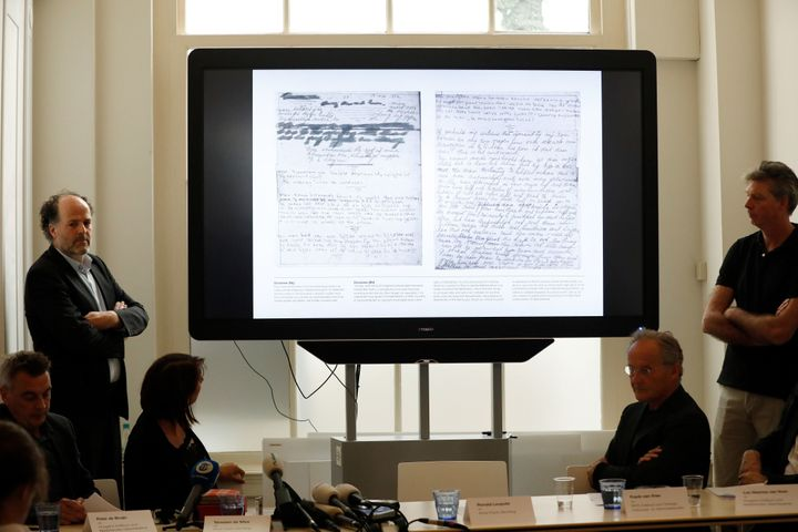 Ronald Leopold (left), executive director of the Anne Frank House, presents two unknown pages of Anne Frank's diary, during a
