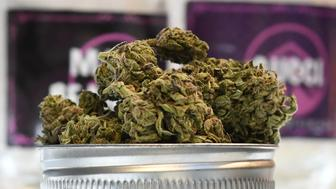 Cannabis is displayed at the Higher Path medical marijuana dispensary in the San Fernando Valley area of Los Angeles, California, December 27, 2017. At the stroke of midnight on January 1, pot lovers in California may raise a joint, instead of a glass of champagne. America's wealthiest state is legalizing the growth, sale and consumption of recreational marijuana, opening the door to the world's biggest market. / AFP PHOTO / Robyn Beck        (Photo credit should read ROBYN BECK/AFP/Getty Images)
