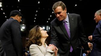 CIA Director nominee Gina Haspel is greeted by U.S. Senate Intelligence Committee ranking member Senator Mark Warner as she arrives to testify at her confirmation hearing on Capitol Hill in Washington, U.S., May 9, 2018. REUTERS/Kevin Lamarque