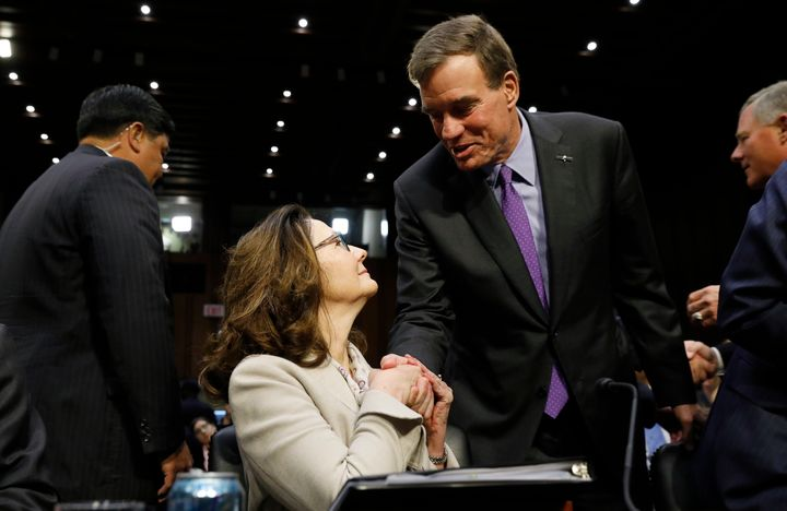 CIA director nominee Gina Haspel is greeted by Sen. Mark Warner before her confirmation hearing on May 9, 2018.