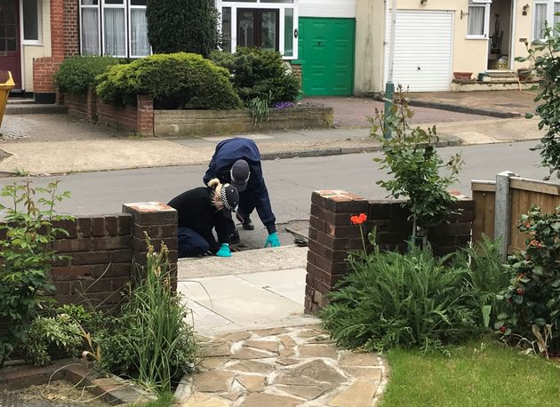 Police officxers searching drains in Ashmour Gardens, Romford, where an 85-year-old womanwasfound...