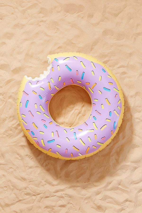 """Get it on <a href=""""https://www.urbanoutfitters.com/shop/lilac-donut-inner-tube-pool-float?category=pool-floats&color=055"""""""