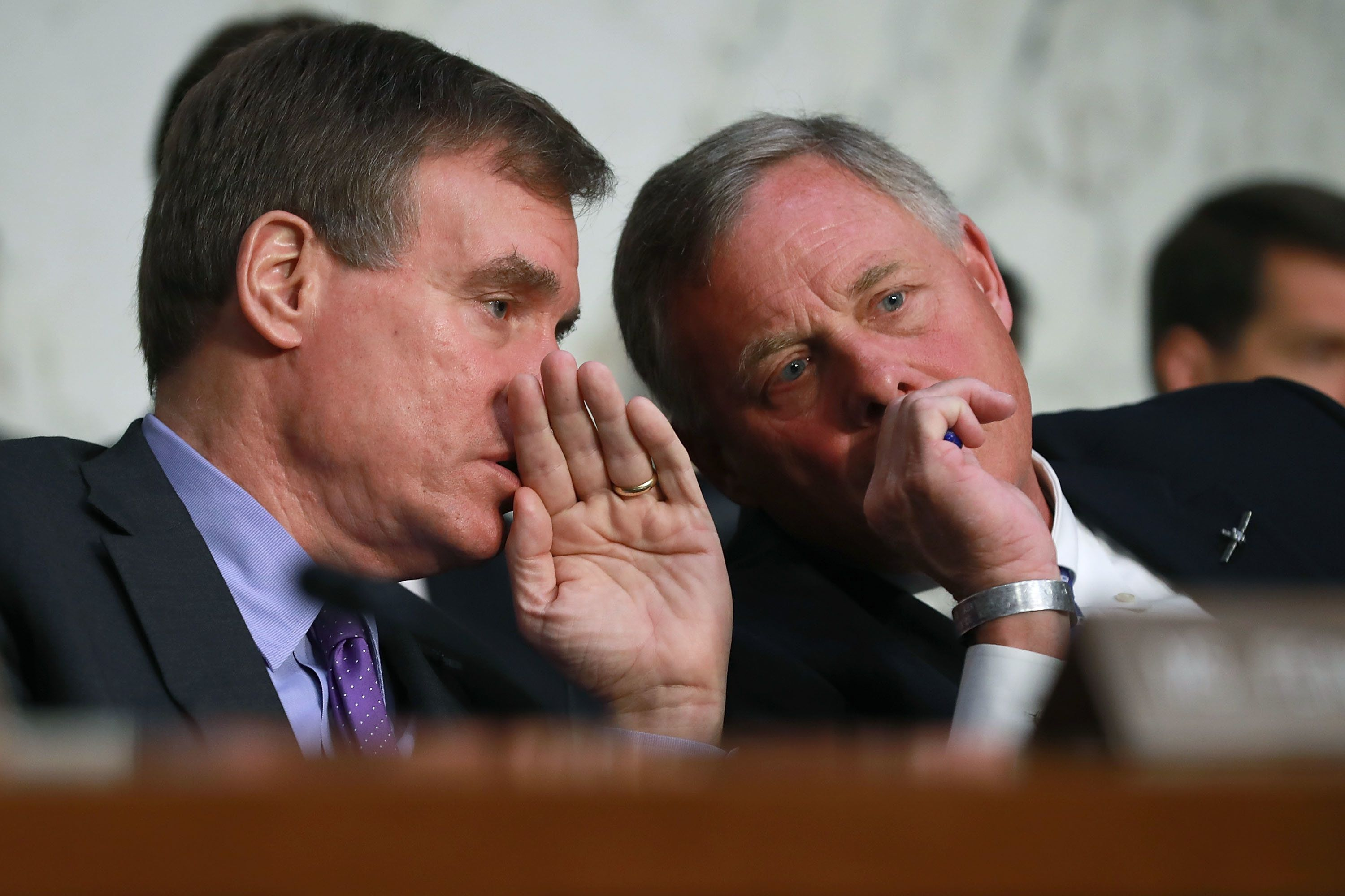 Sen. Richard Burr, chairman of the Senate intelligence committee talks with Warner during Haspel's confirmation