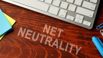 Net neutrality written on a wooden surface. Neutral internet concept.