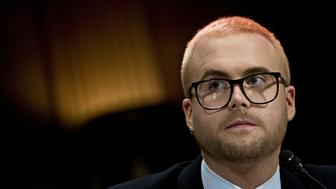 Christopher Wylie, a whistleblower and former employee with Cambridge Analytica, listens during a Senate Judiciary Committee hearing in Washington, D.C., U.S., on Wednesday, May 16, 2018. Cambridge Analytica, a U.K.-based data broker that improperly gained access to tens of millions of Facebook users personal data, announced its dissolution earlier this month after using the Facebook data in targeted influence campaigns for Donald Trumps 2016 presidential campaign. Photographer: Andrew Harrer/Bloomberg via Getty Images