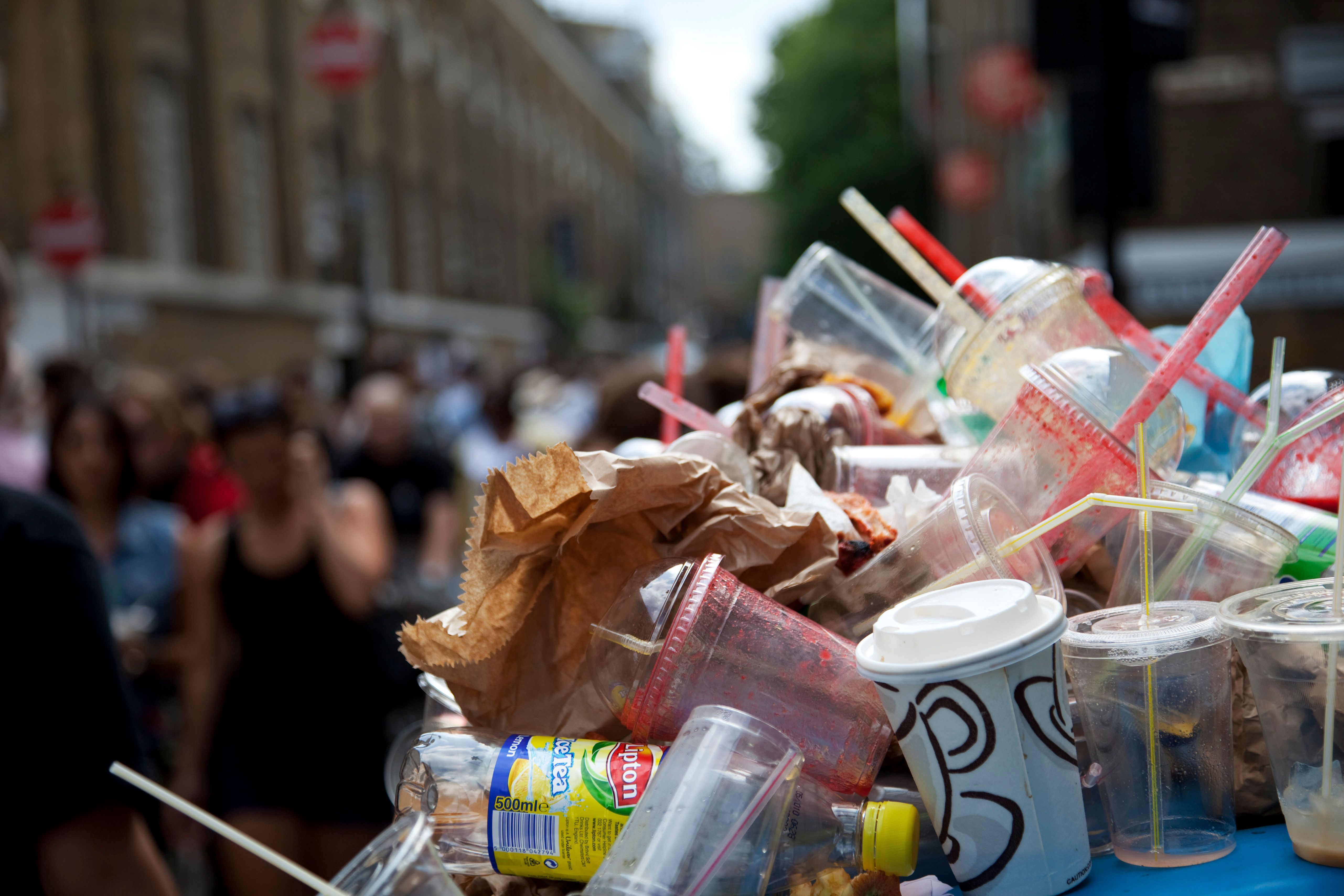Rubbish overflows the bins on Brick Lane Market. Extreme amounts of plastic and paper trash litter the streets. This market is a weekly event in London's East End. (Photo by In Pictures Ltd./Corbis via Getty Images)