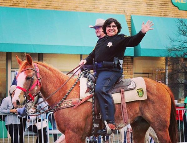 Lupe Valdez rides in a Mardi Gras parade in Dallas in February 2017.