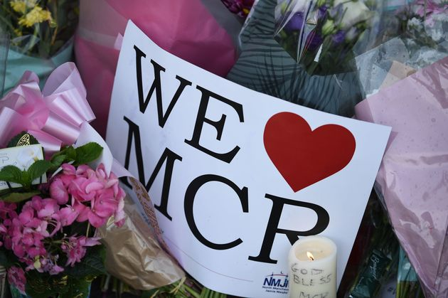 Messages of support and floral tributes were placed outside the Manchester Arena after the