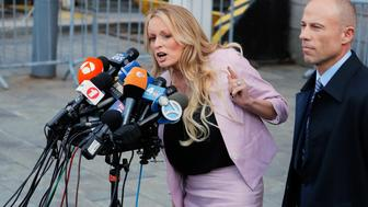 Adult film actress Stephanie Clifford, also known as Stormy Daniels, speaks to media along with lawyer Michael Avenatti (R) outside federal court in the Manhattan borough of New York City, New York, U.S., April 16, 2018. REUTERS/Lucas Jackson